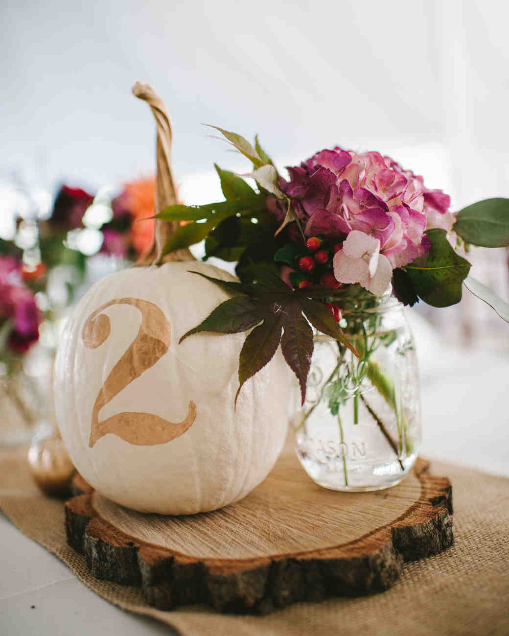 mason jar flower holder with pumpkin table number