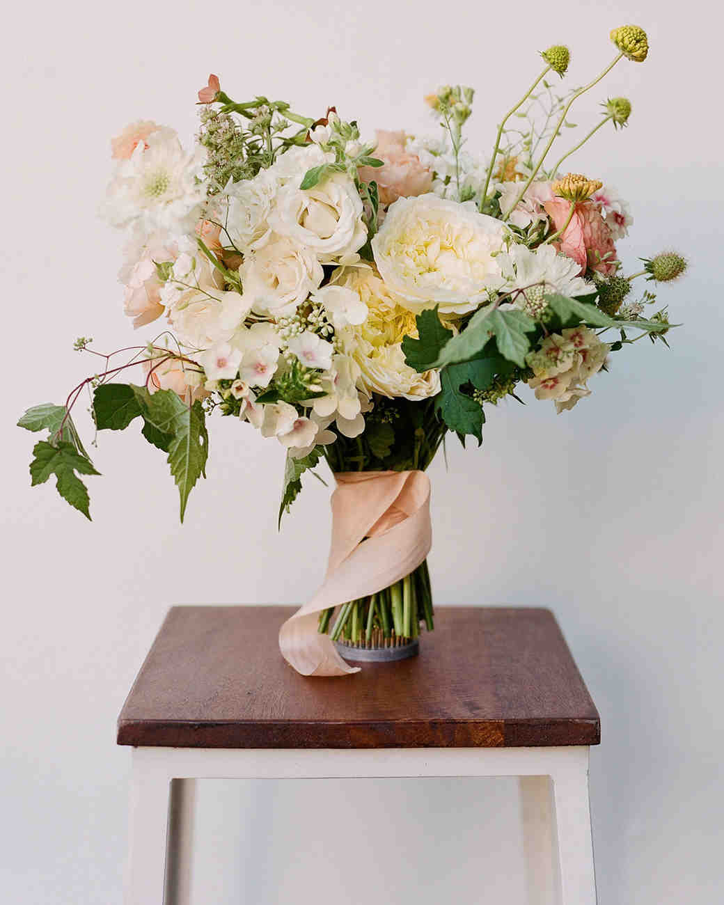 bouquet of white and pink roses with grapevine ivy and mint