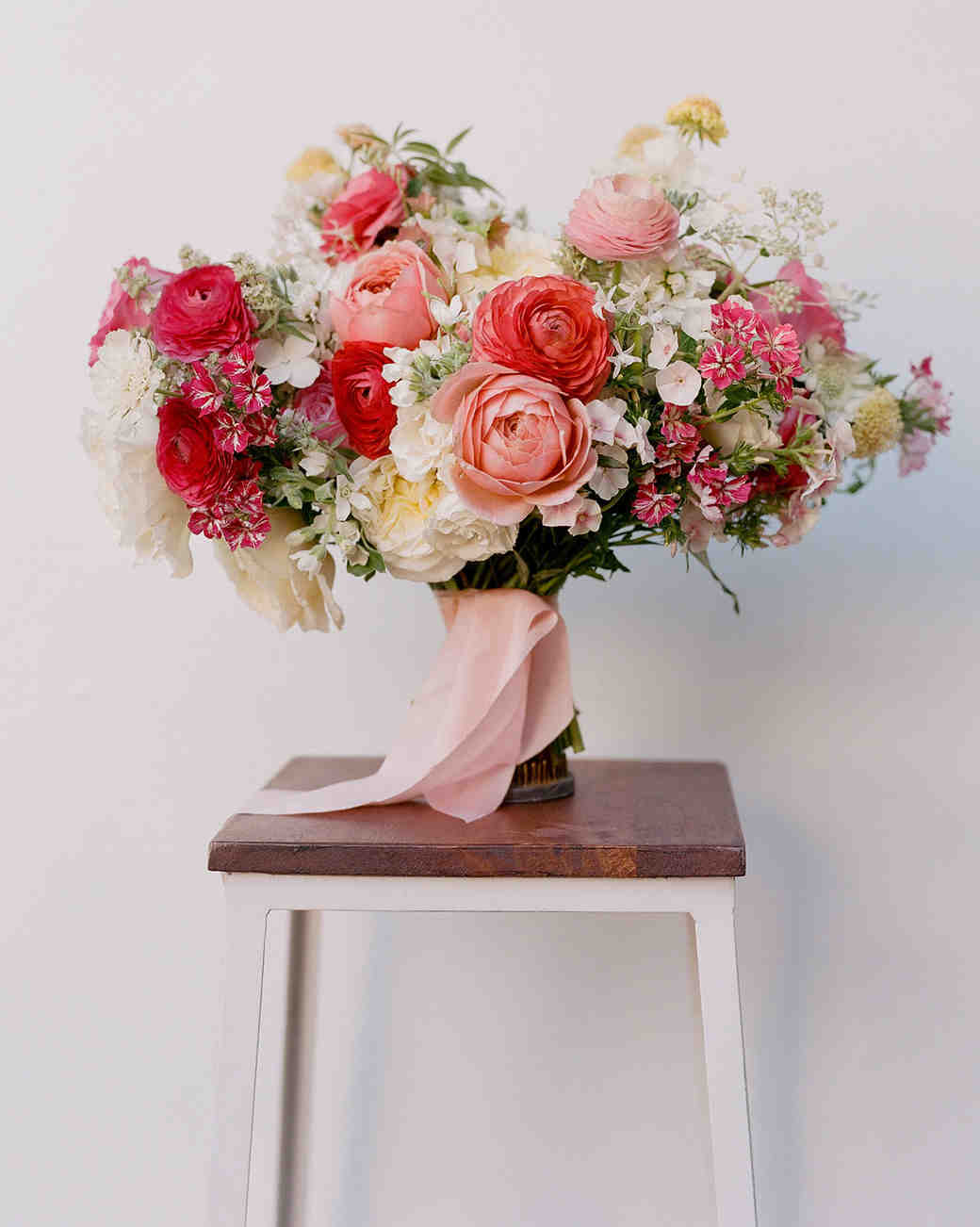 bouquet of red and pink roses with ranunculus