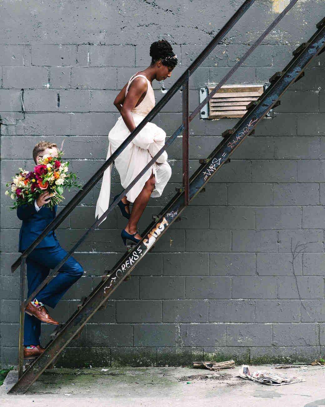 steph tim wedding couple climbing stairs