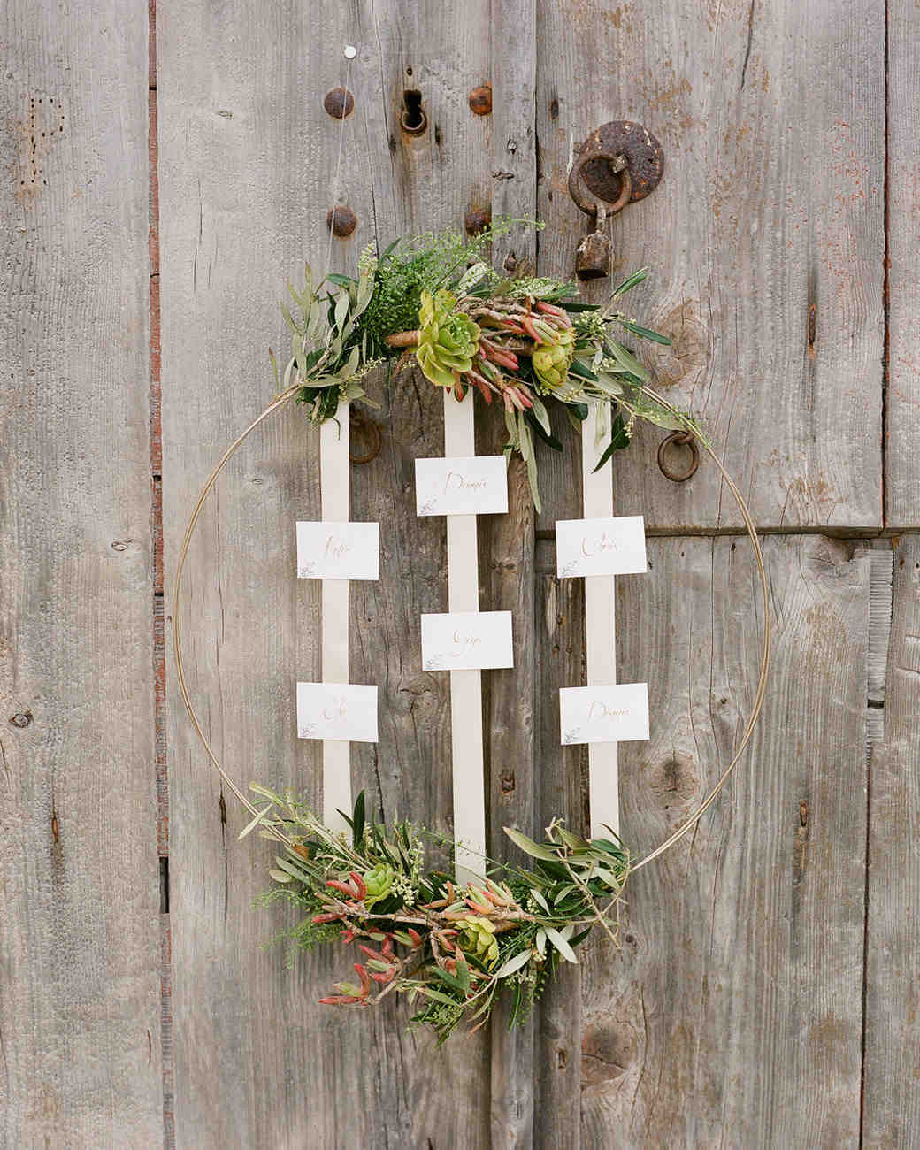 wedding wreaths with exposed metal displaying escort cards