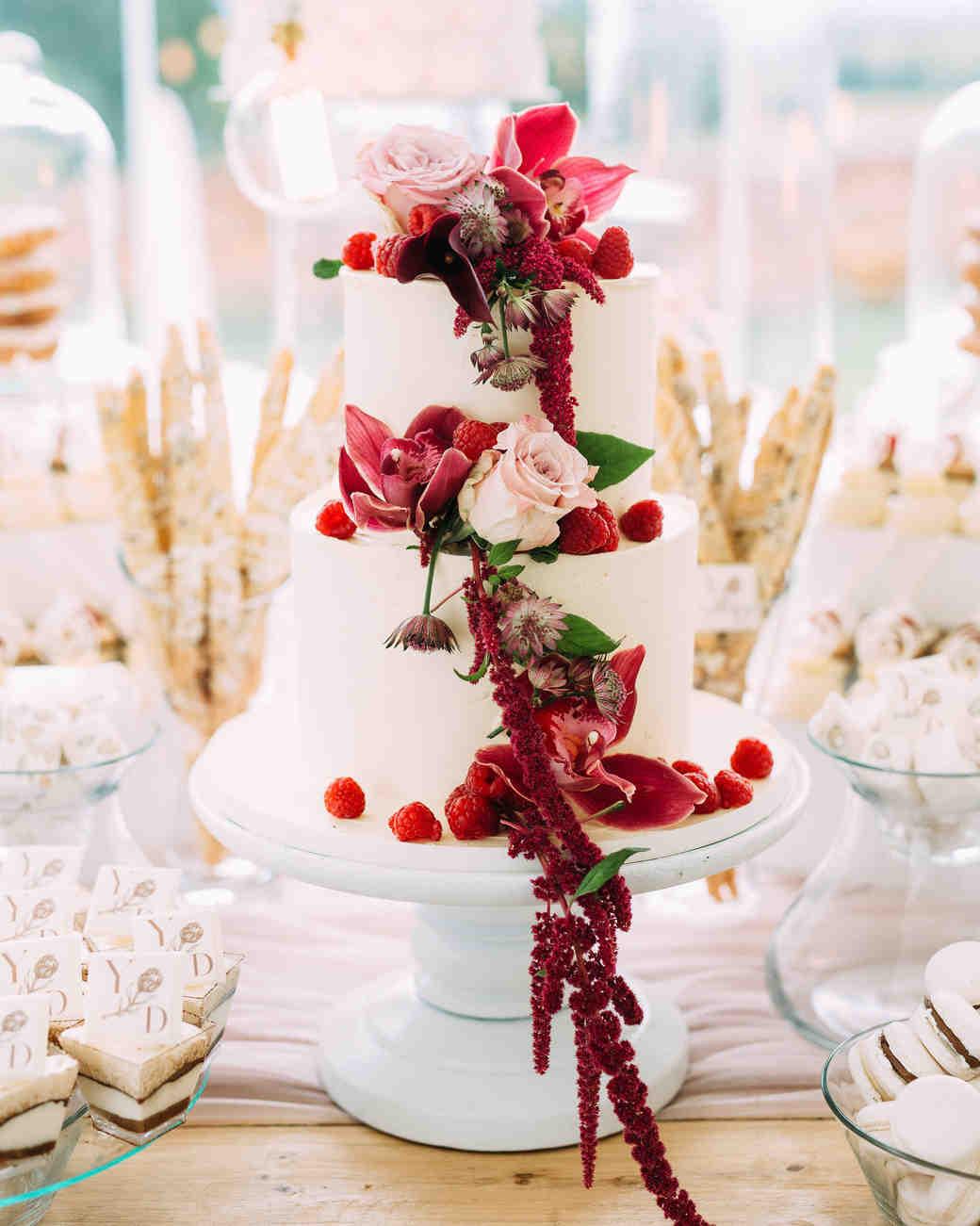 yolana douglas wedding cake with berries and flowers