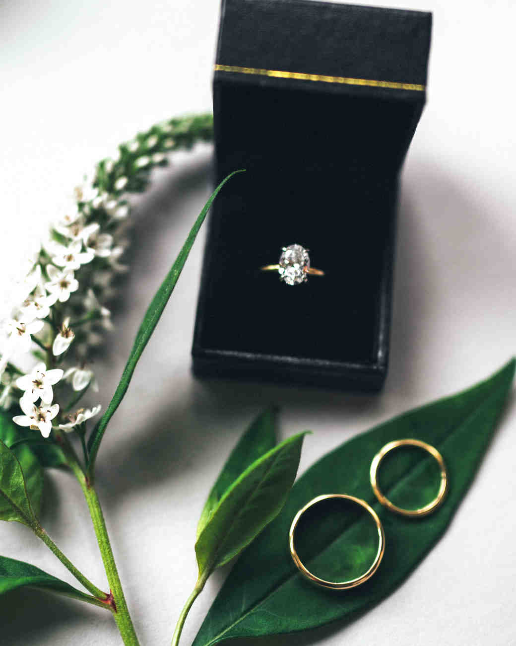 wedding jewelry bands with floral greenery
