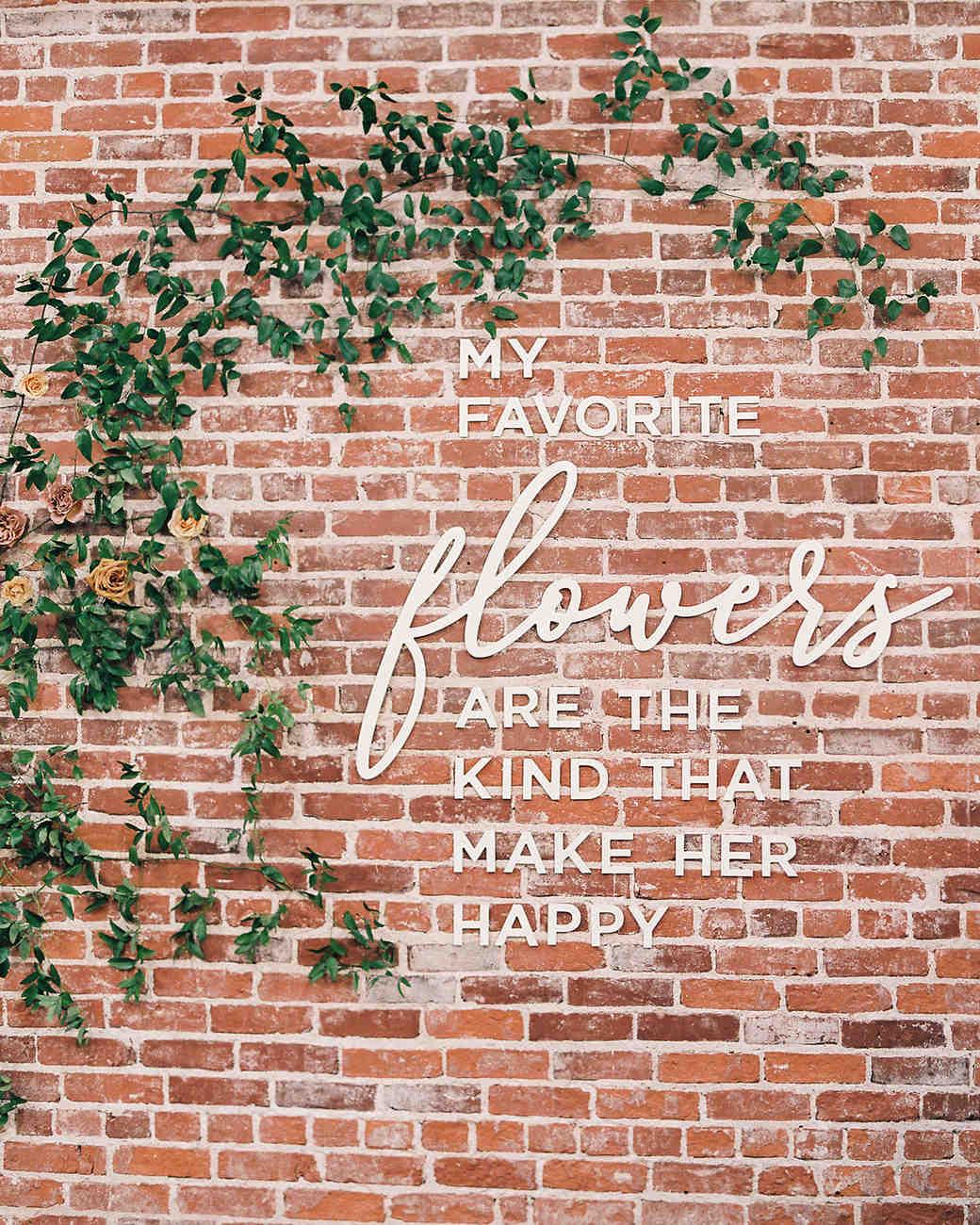 brooke dalton wedding quote on brick wall