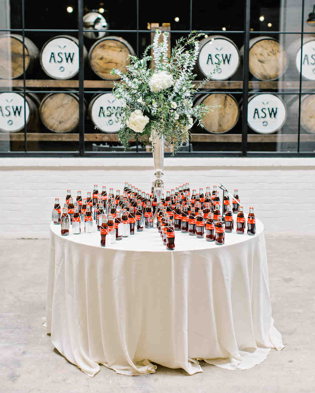 favor display with tall centerpiece