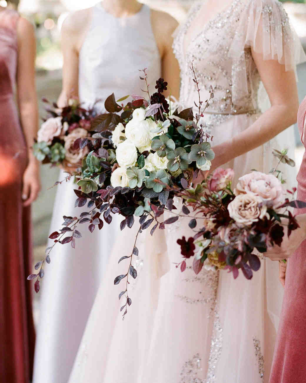 nature color scheme bouquet with pops of plum blooms and greenery