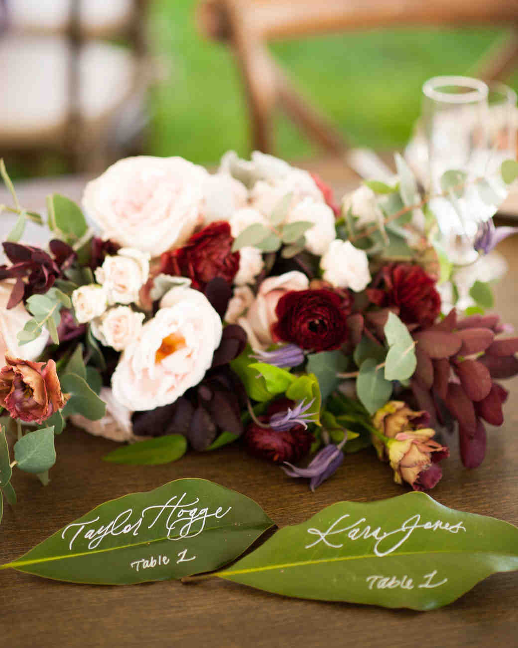 magnolia leave place cards with white hand-calligraphy