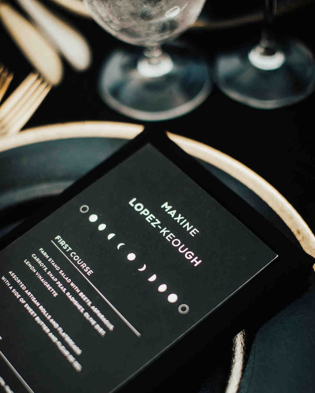 matte black reception menu with moon phase design