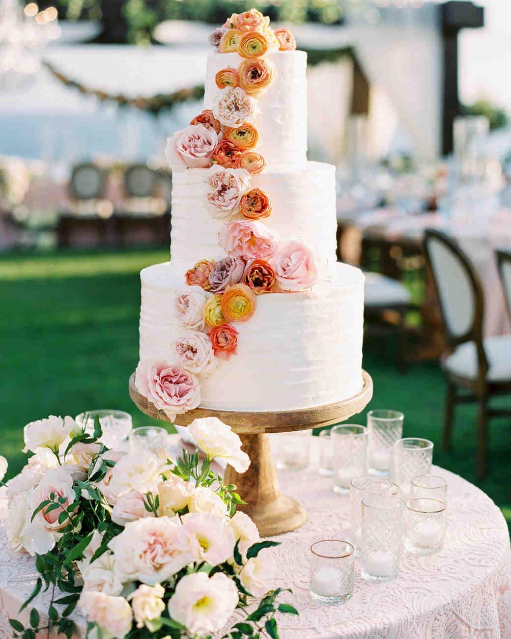 mykaela and brendon wedding white cake with cascading flowers