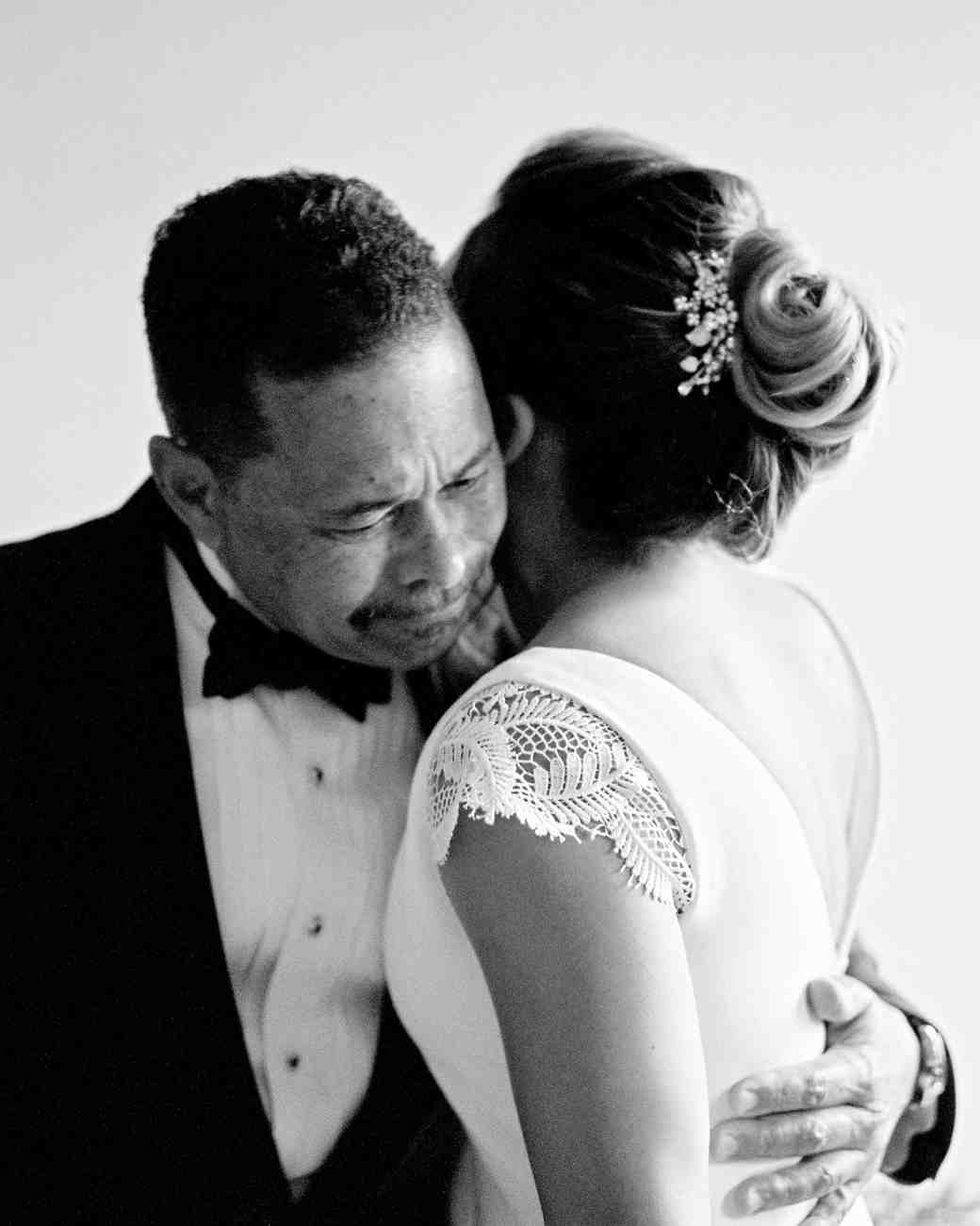 wedding bride and father hug in formal attire