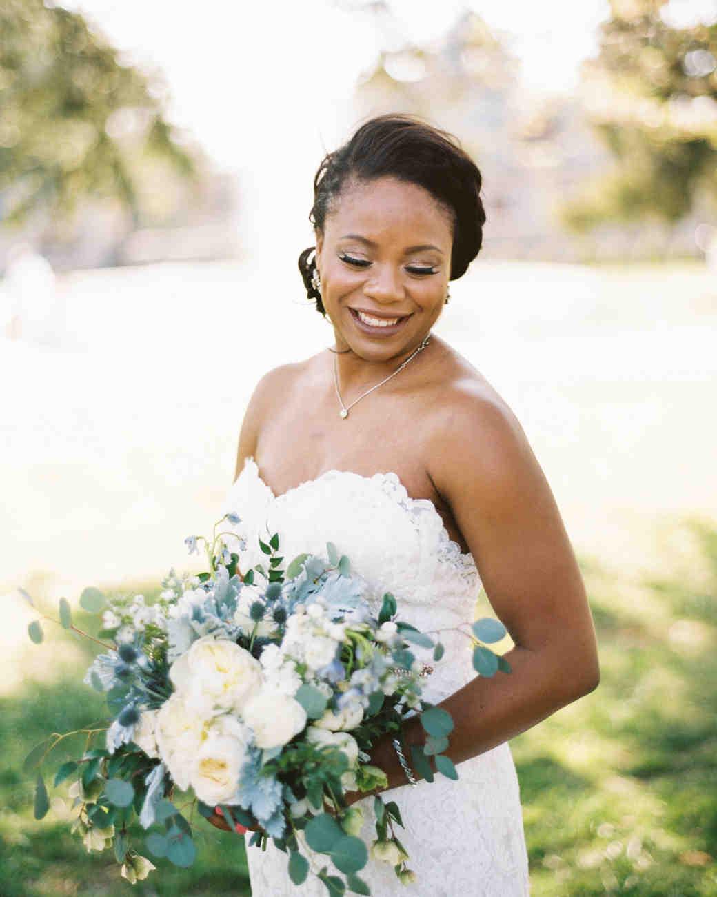 wedding bride holding bouquet white blue flowers