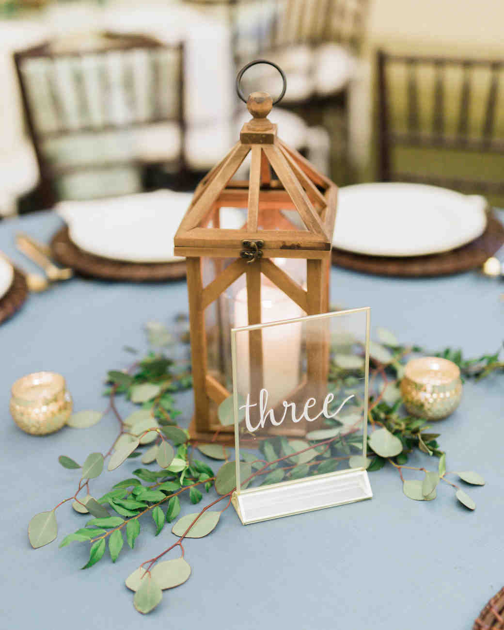 reception table number three sign with white candles