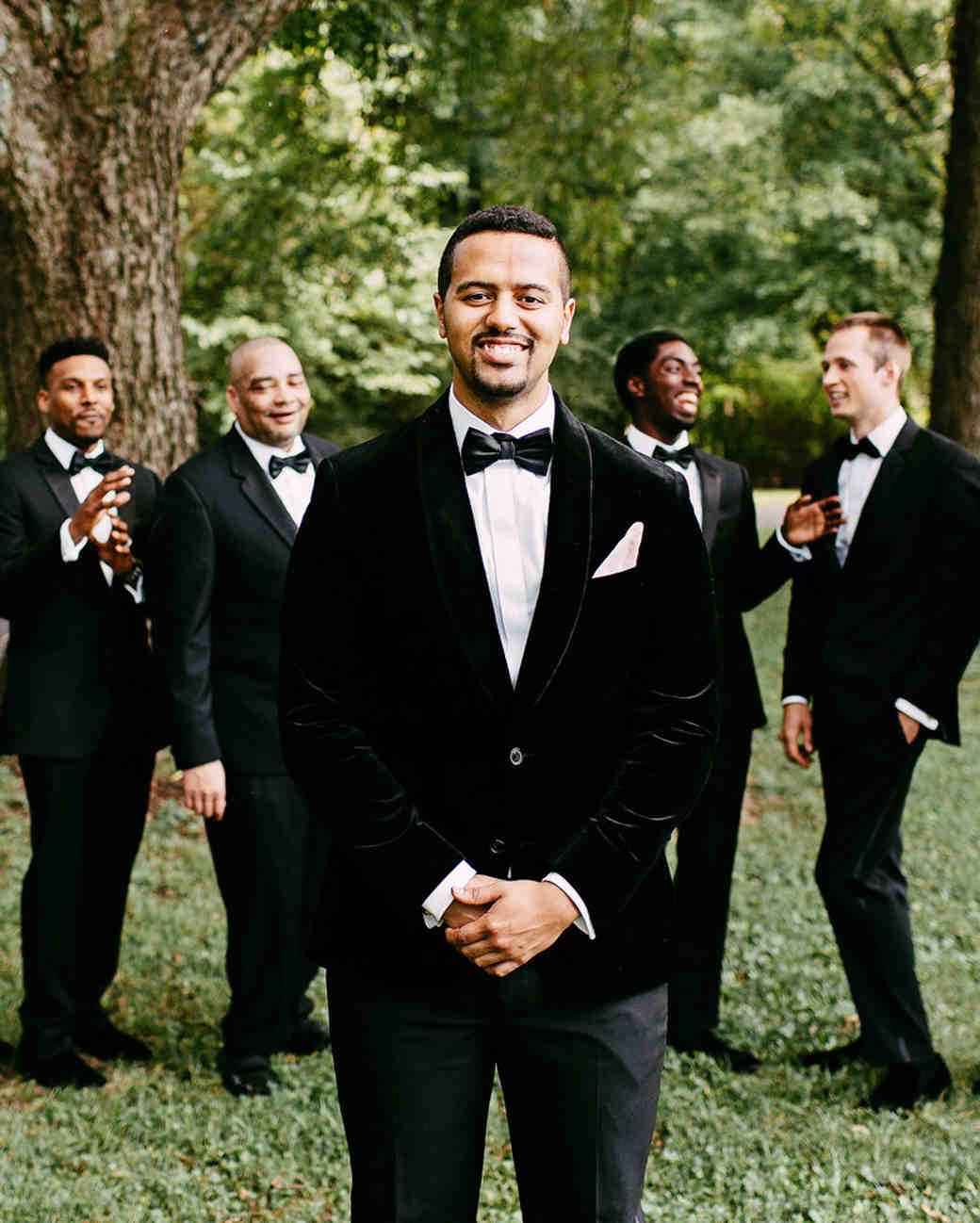 groom standing in front of groomsmen