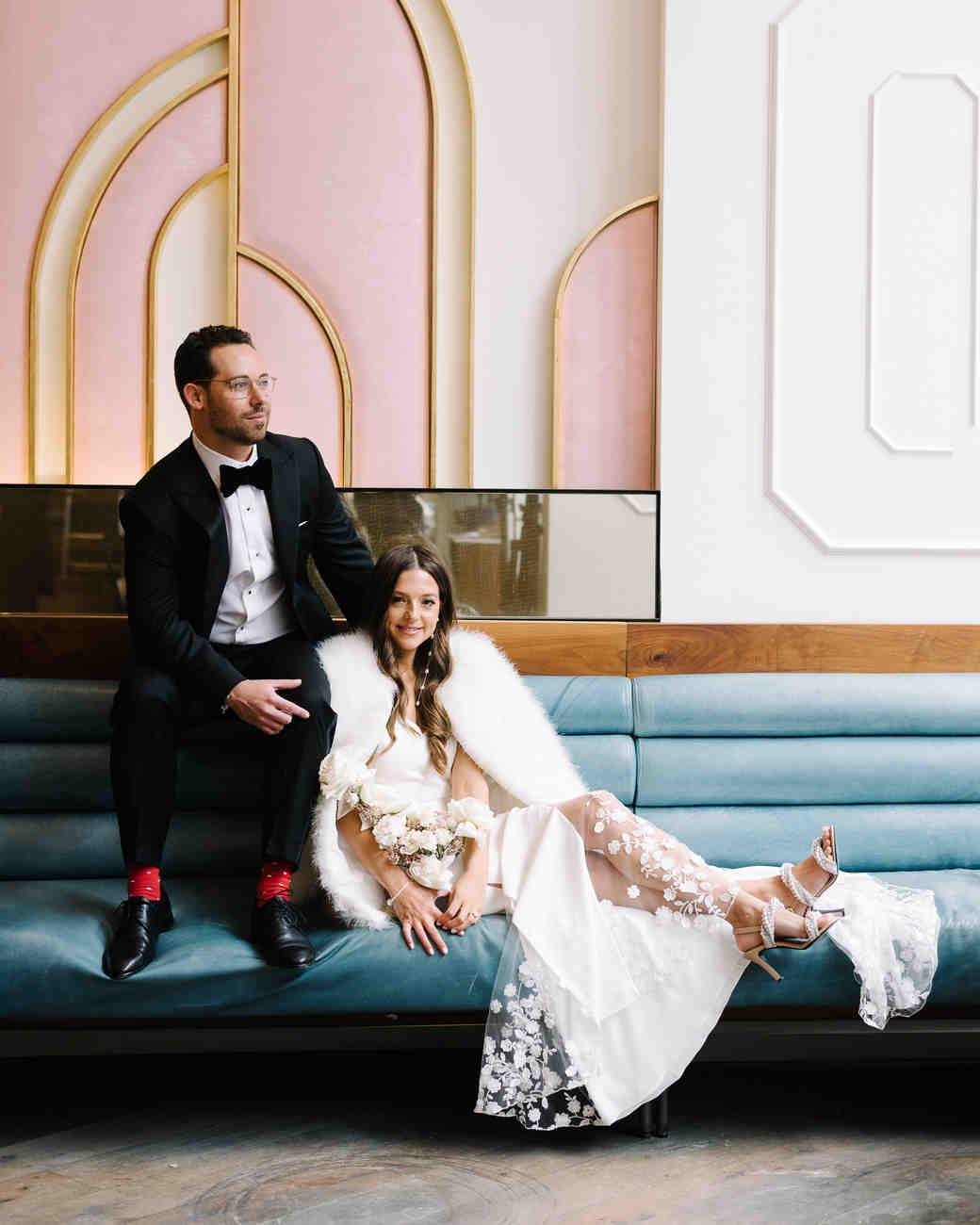 krista will wedding couple posing on built in sofa art deco design