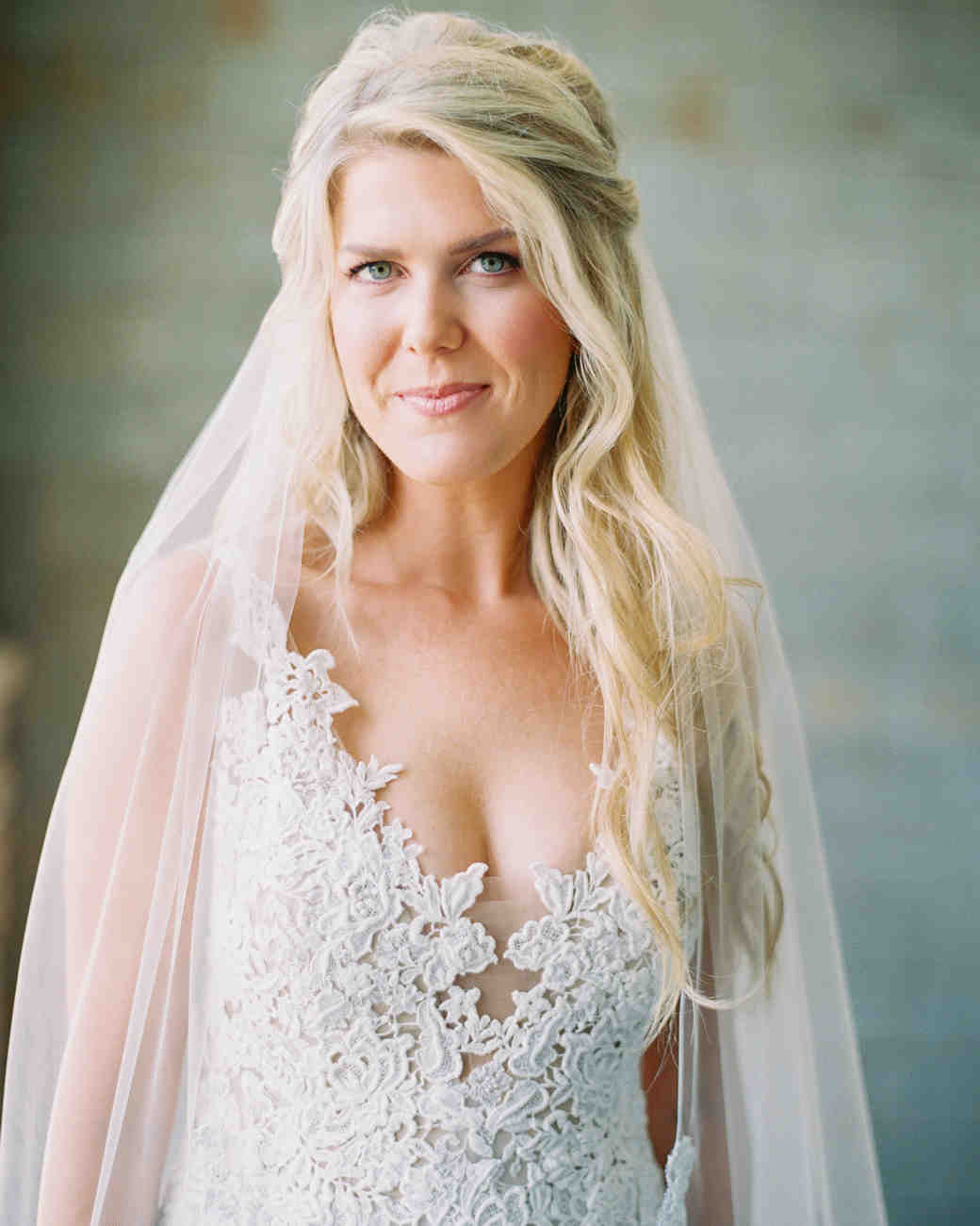 mykaela and brendon wedding bride wearing lace v neck gown
