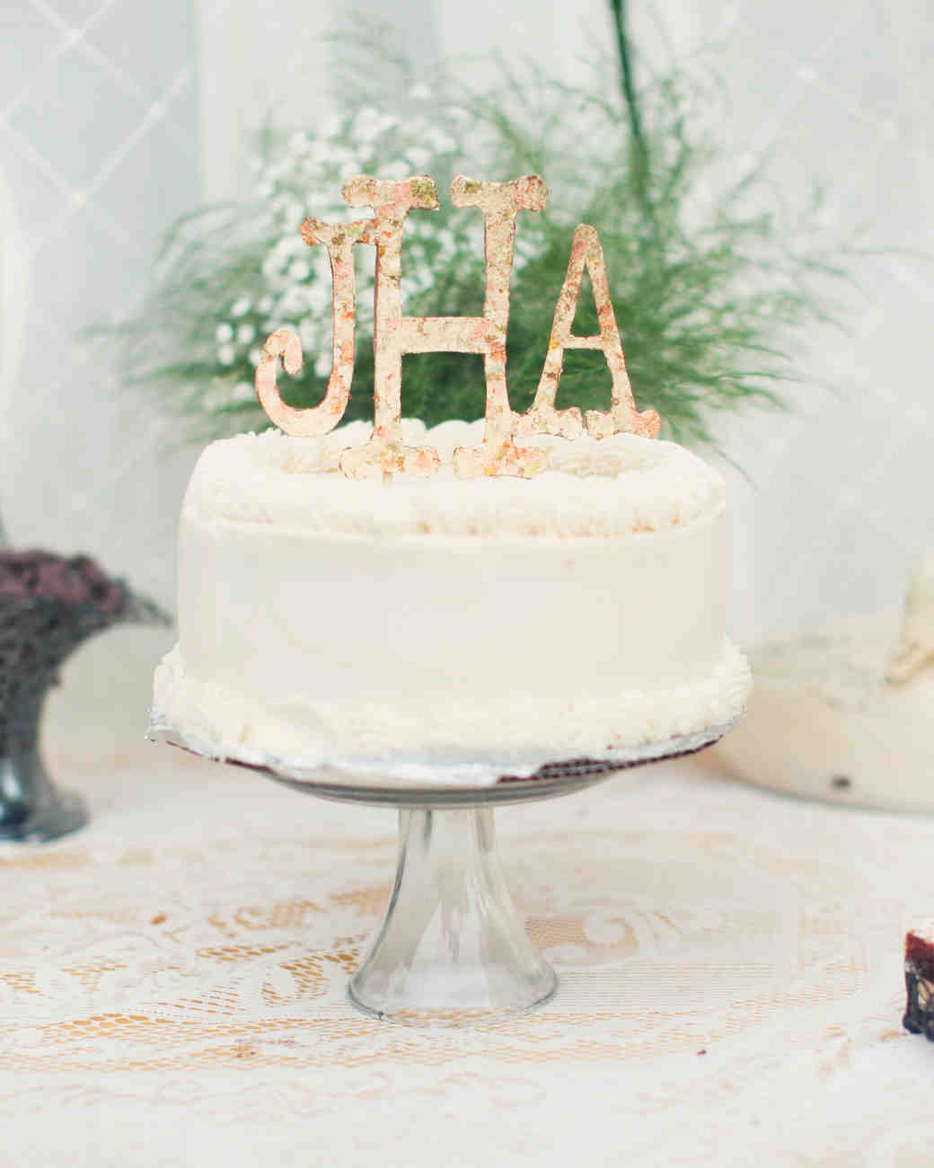 Single Tiered White Wedding Cake With Floral Monogram Topper
