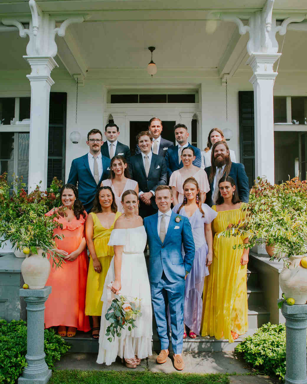 colorful wedding party standing on steps