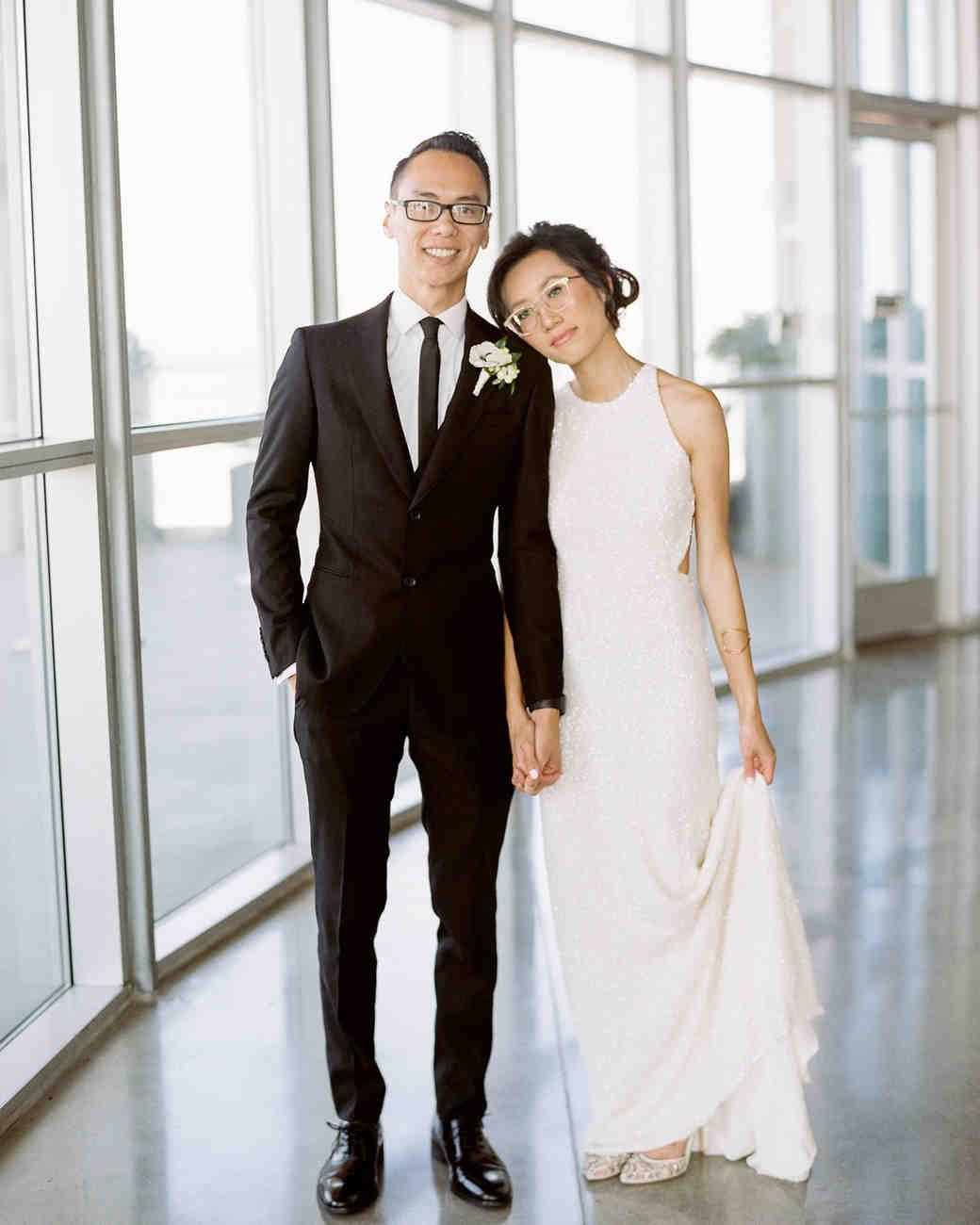 wedding bride and groom pose near windows