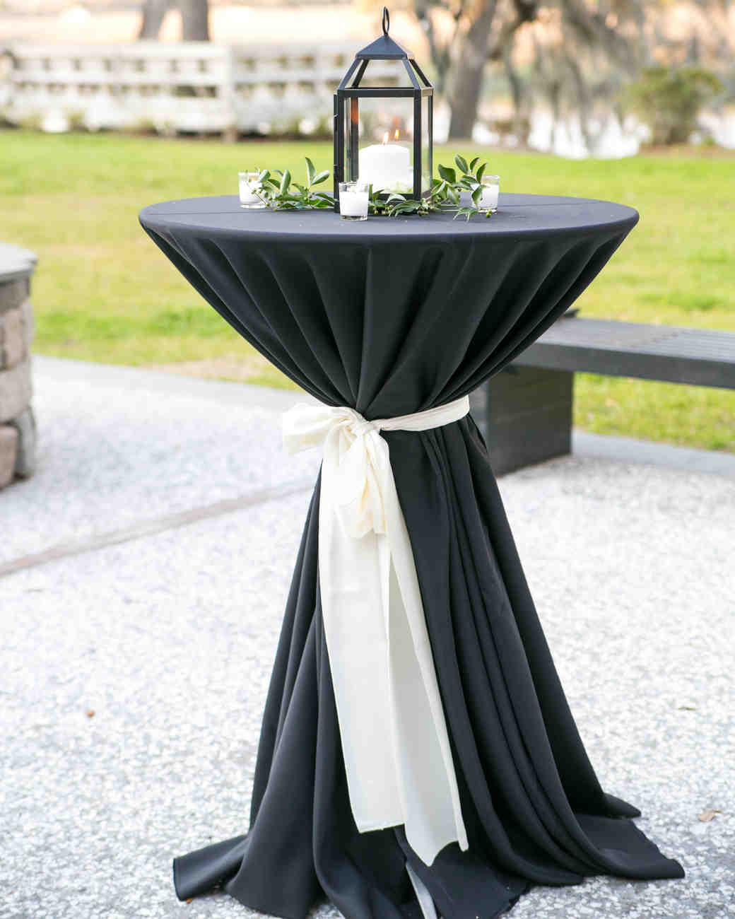 black white cocktail table with lantern