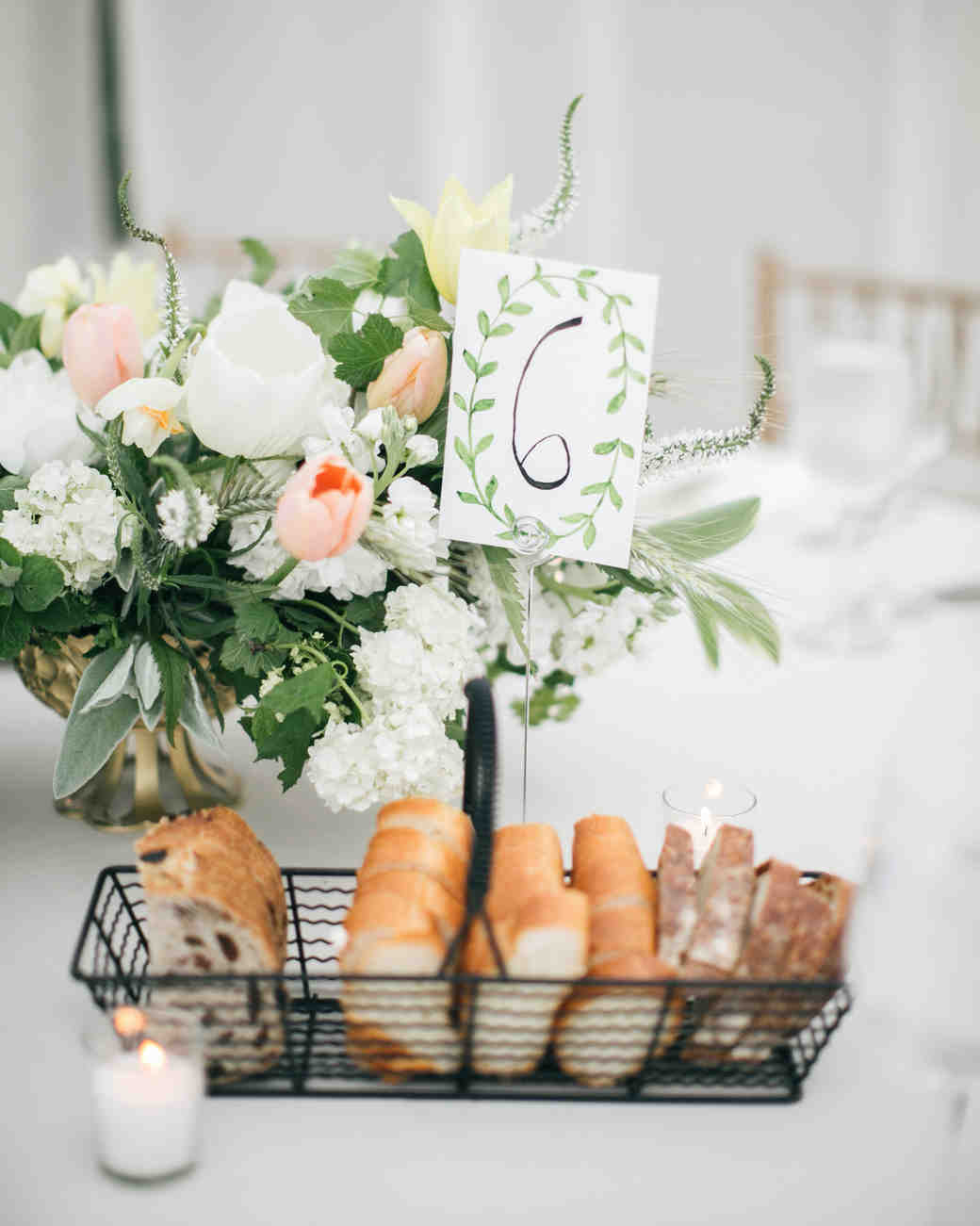 wire basket of bread holding table number