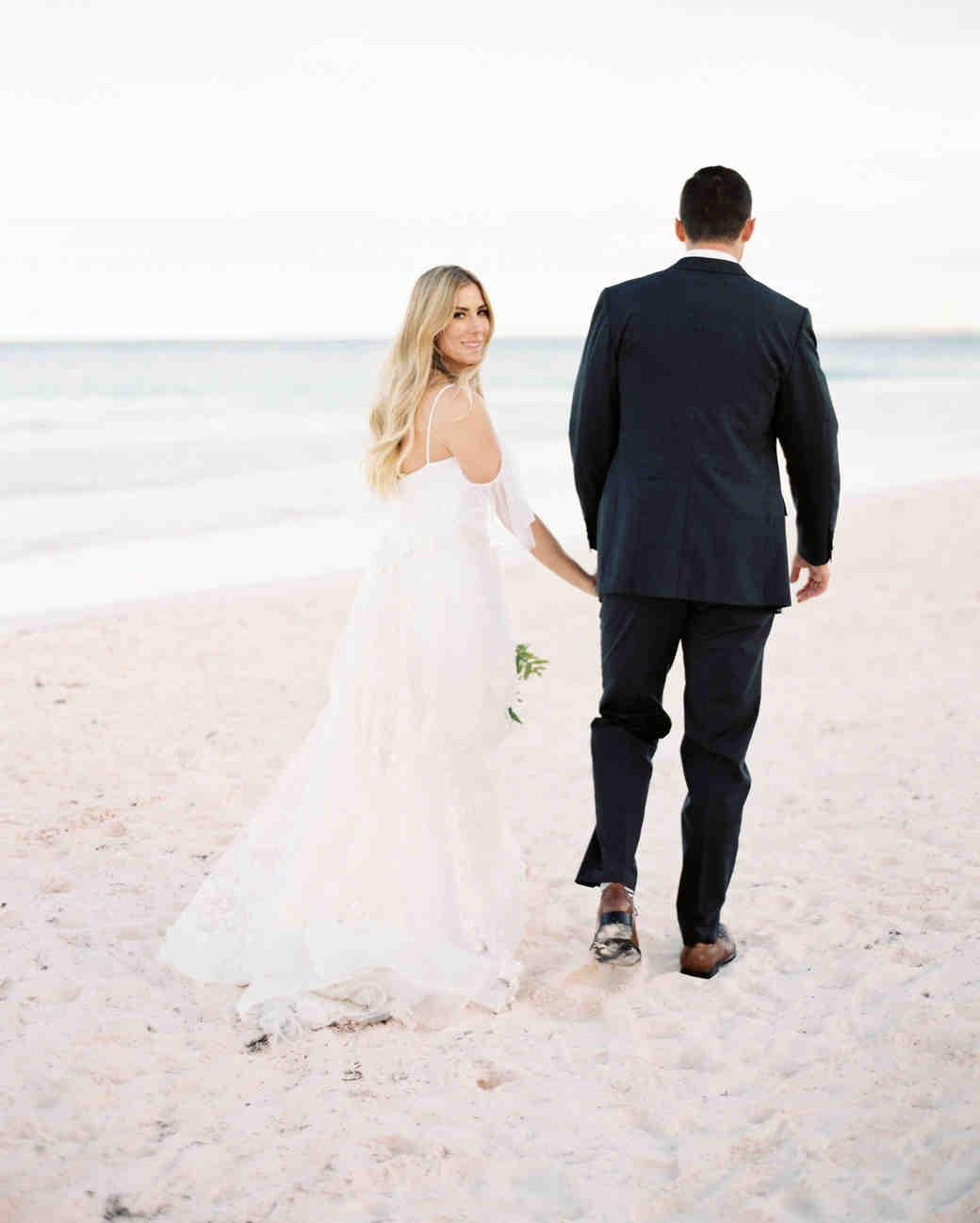 Elizabeth and Chuck walking on beach
