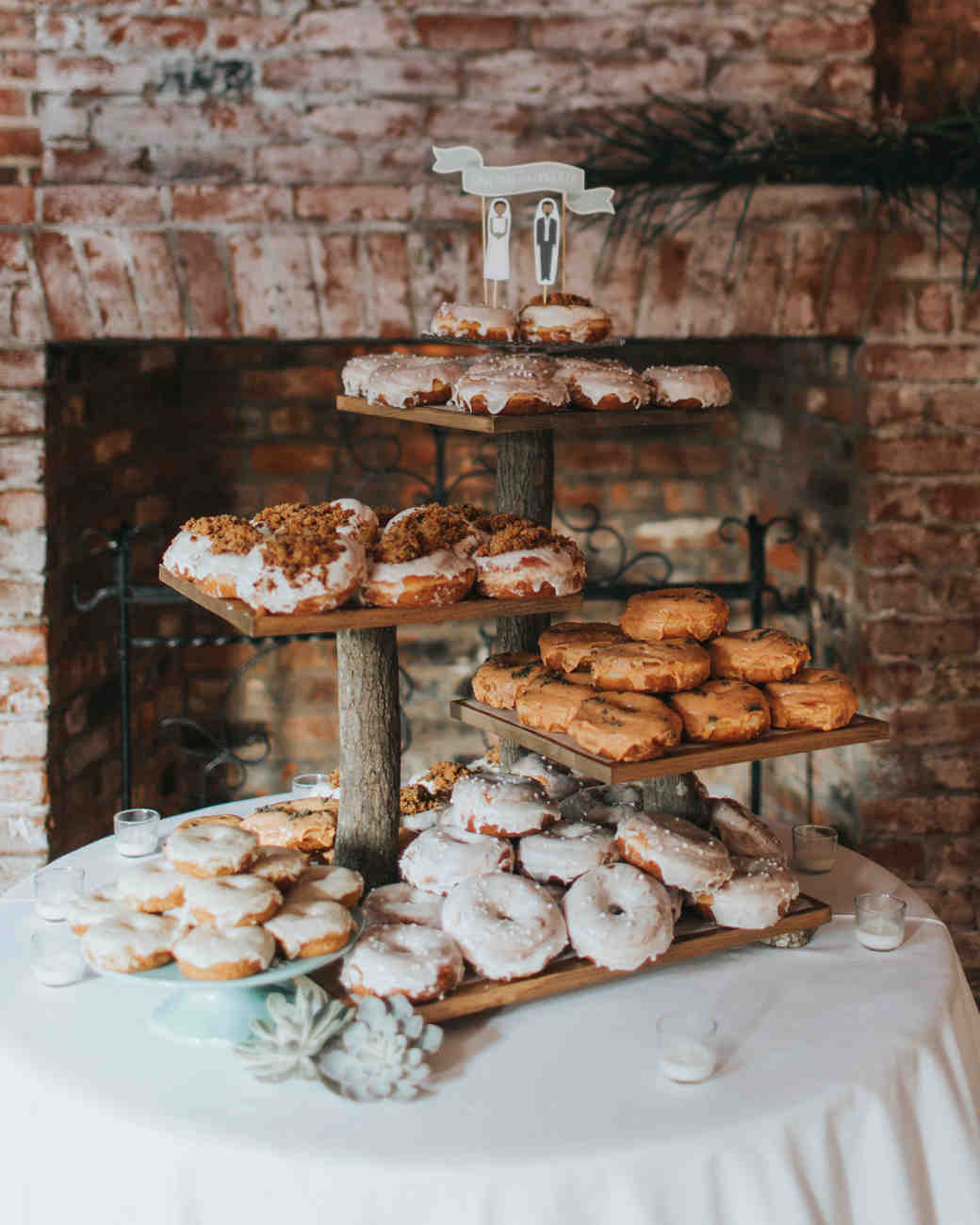 wedding donuts on wooden stand