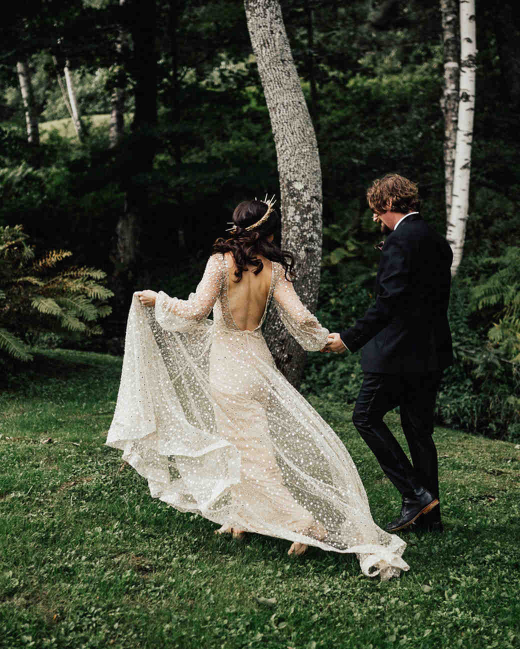 bride and groom forest surrounded photo
