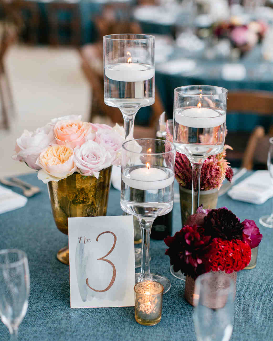 Modern and vintage glass and brass wedding centerpiece