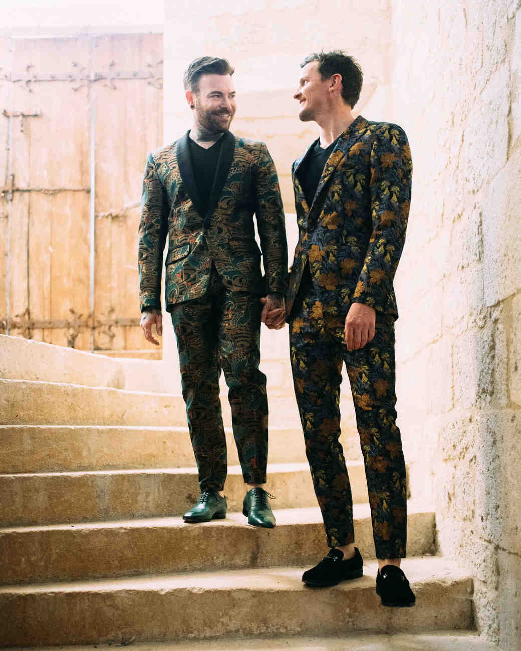 thomas jared wedding couple holding hands on stone stairs