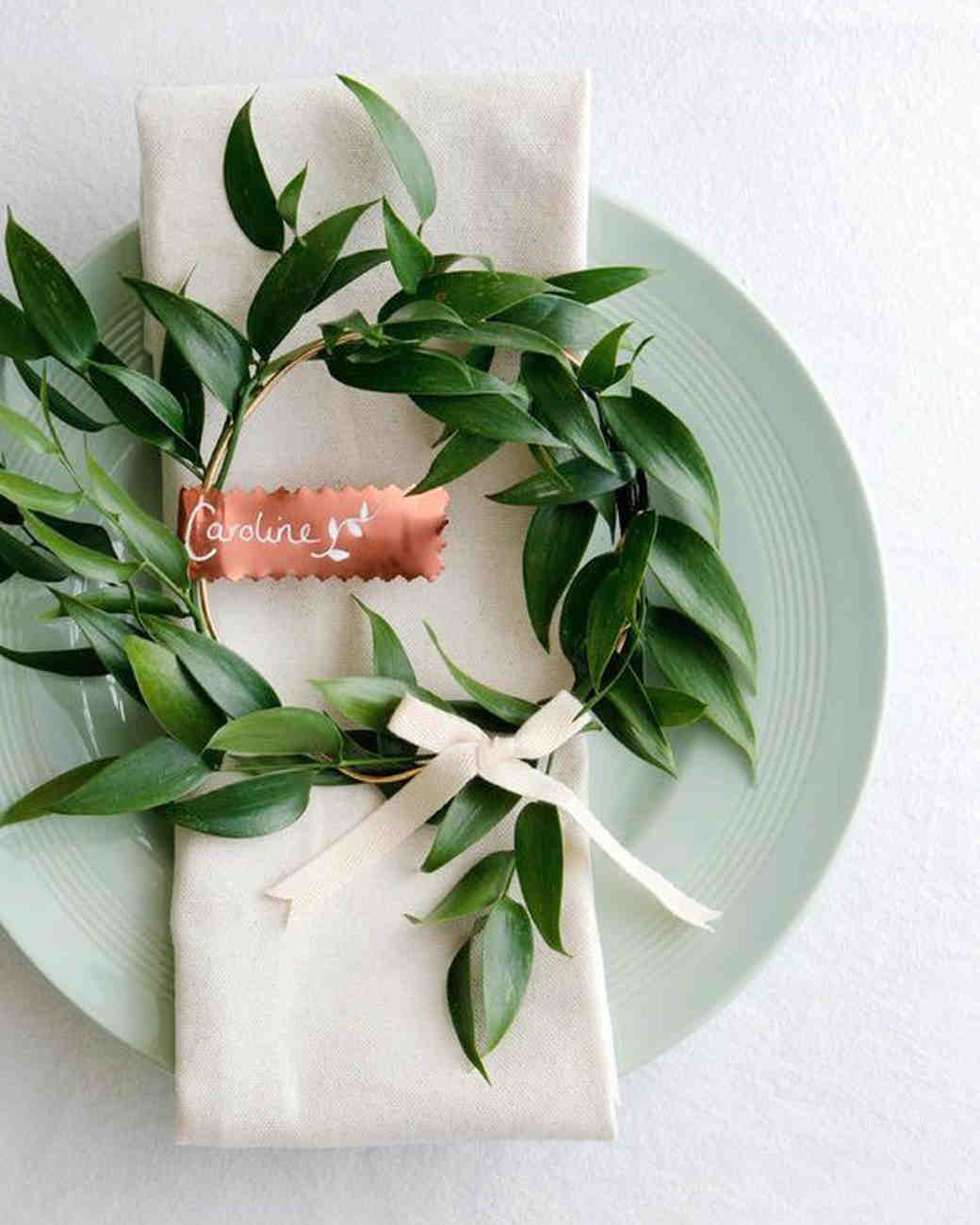 wedding wreath with copper name tag on top of plate