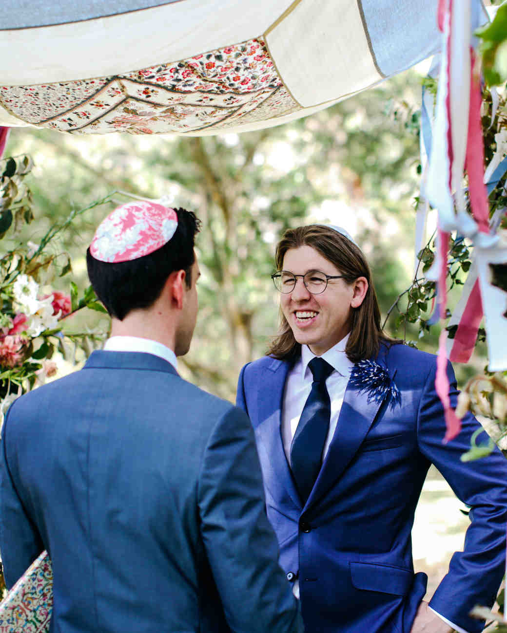 red and blue floral matching yarmulke groom officiant outdoors