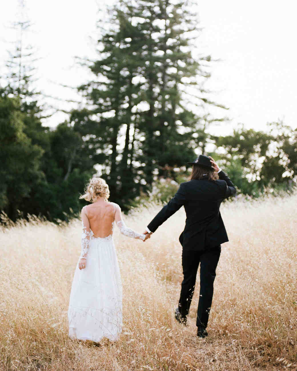 amanda chase wedding backs of couple in tall grass