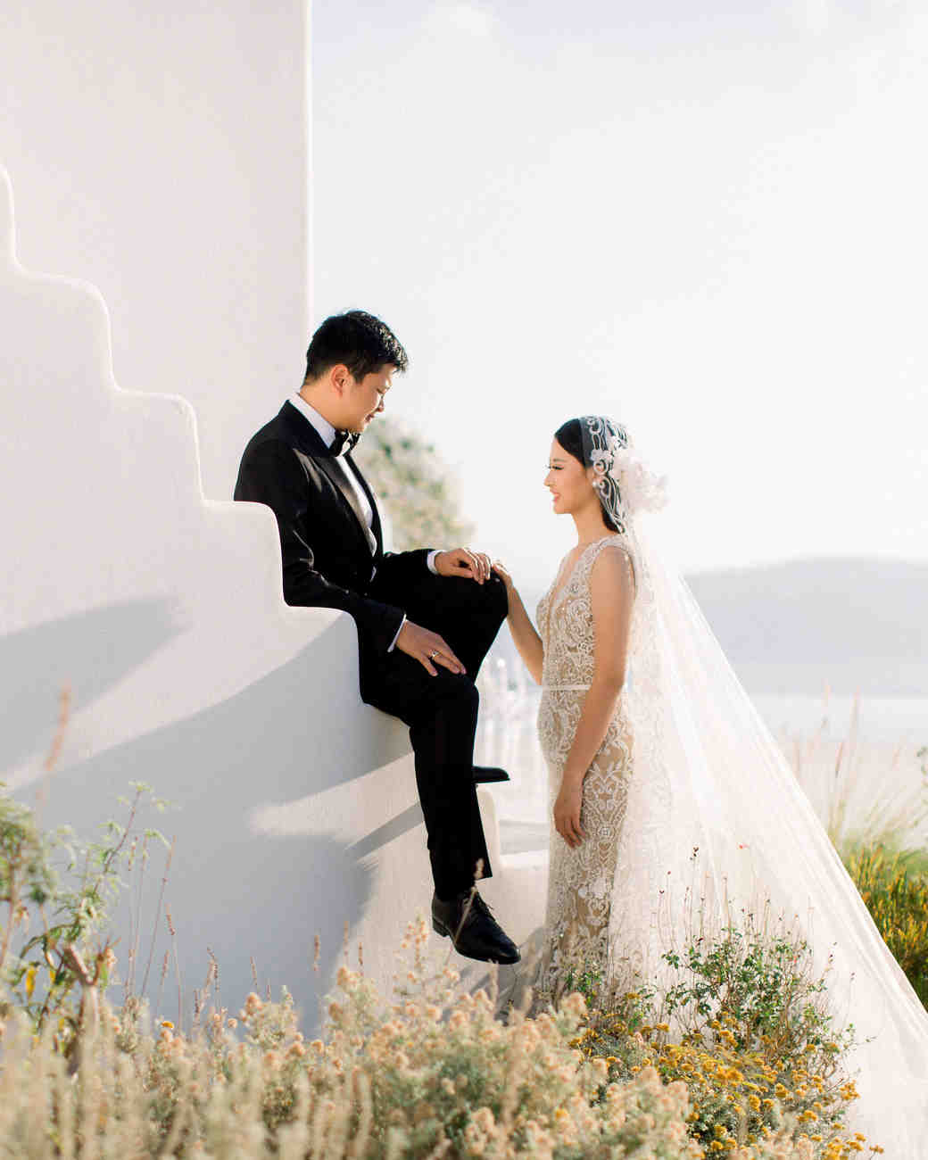 angie prayogo greece wedding couple groom sitting on stairs