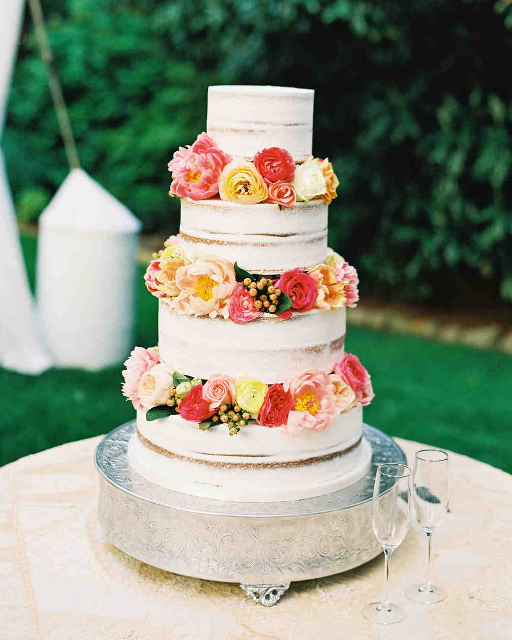 cakes with floral tiers colorful semi-naked