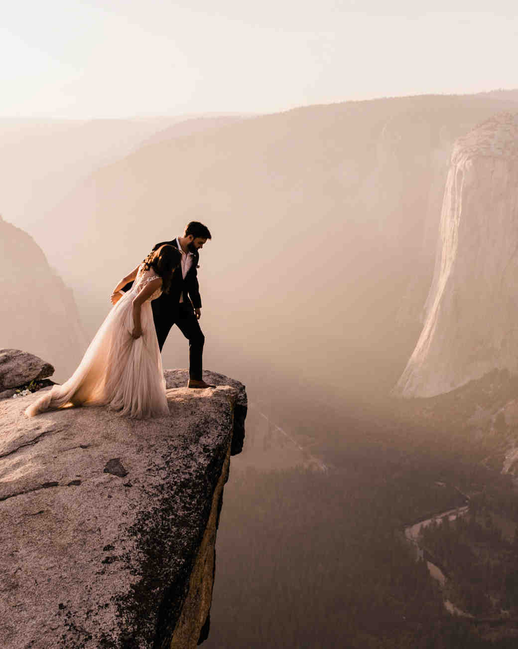 epic wedding photos abbi hearne couple on cliff
