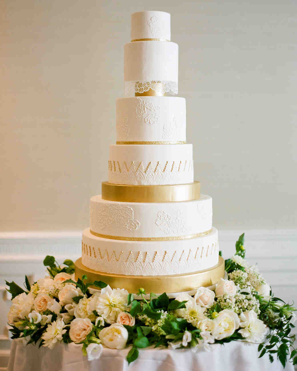 large wedding cake with gold details