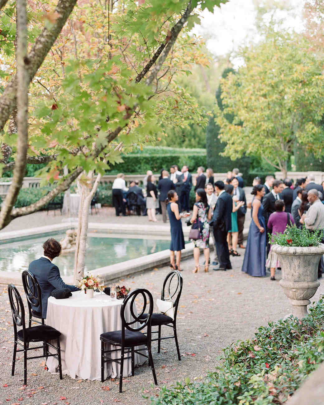guests gather for cocktail hour in Beaulieu's Garden area