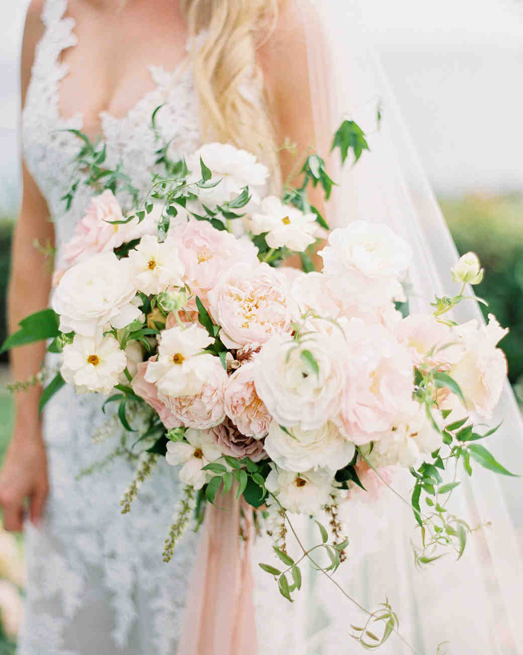 mykaela and brendon wedding brides bouquet of pale pink and white roses