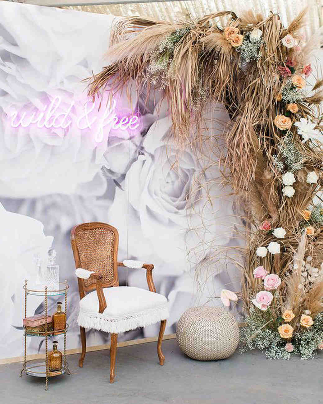 wild and free neon sign in bohemian lounge area