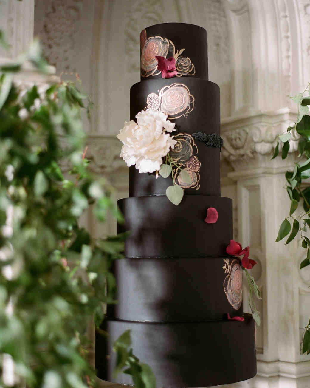 black wedding cake with floral details