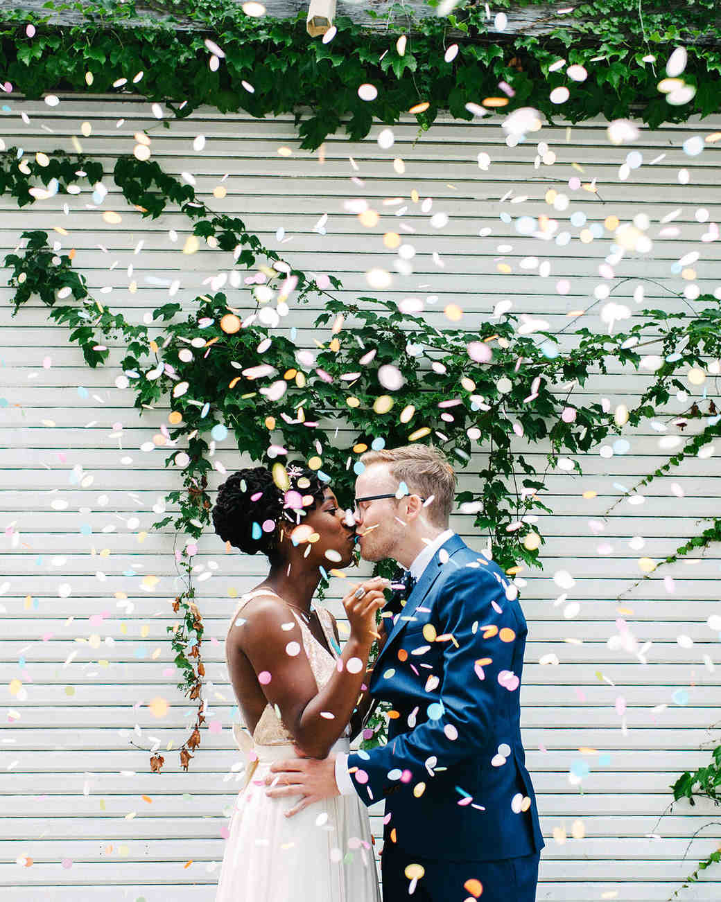 steph tim wedding couple first look kiss confetti