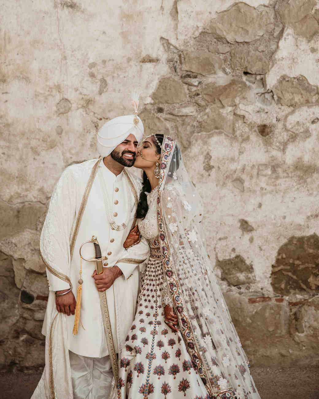 indian wedding couple bride kissing grooms cheek