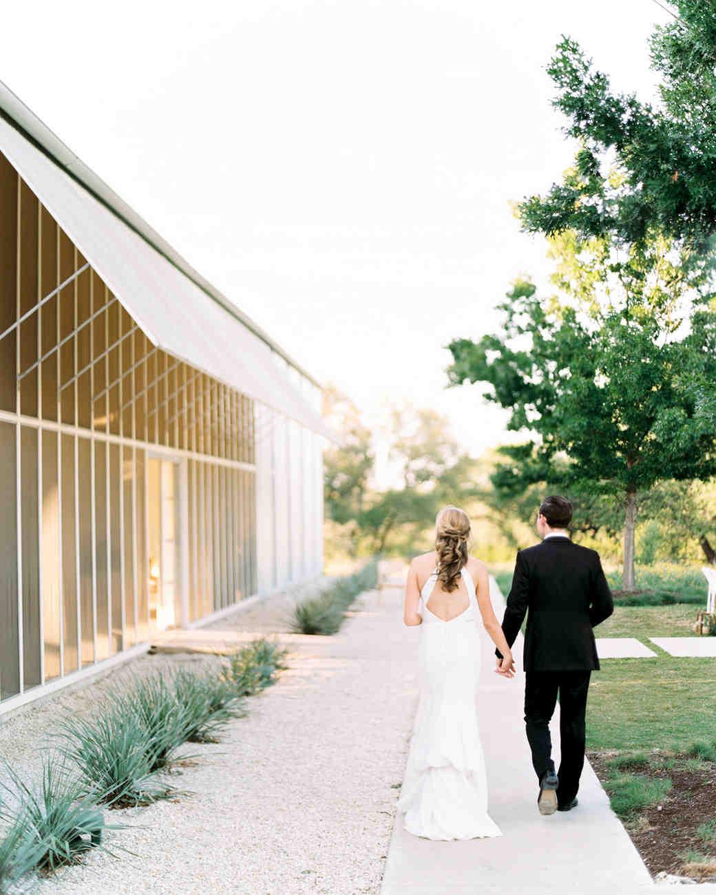 amanda chuck wedding couple walking by venue