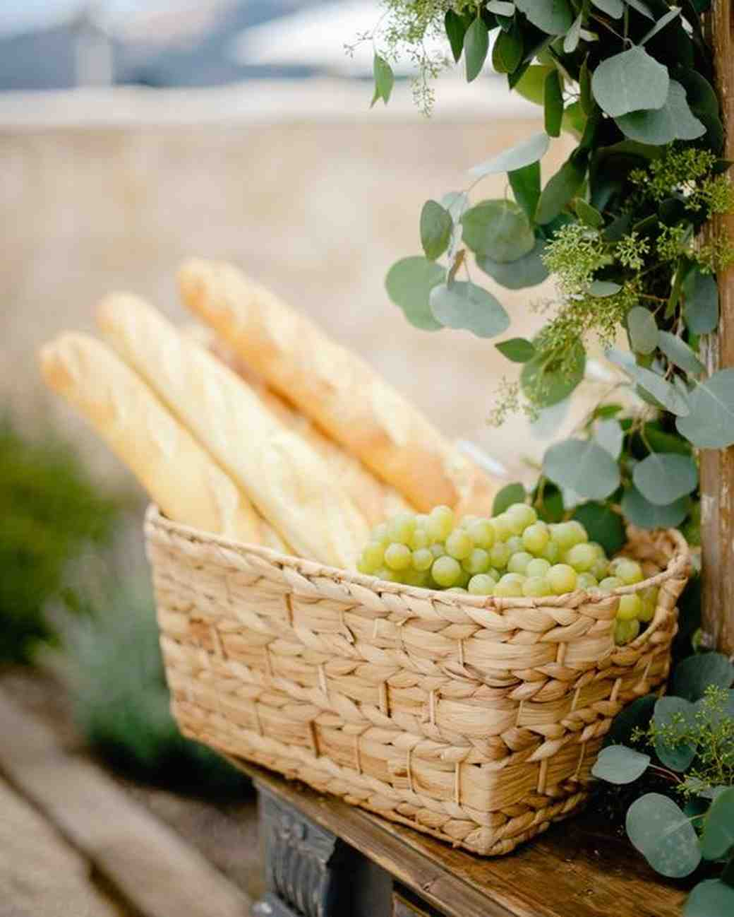 grapes and baguettes in woven baskets