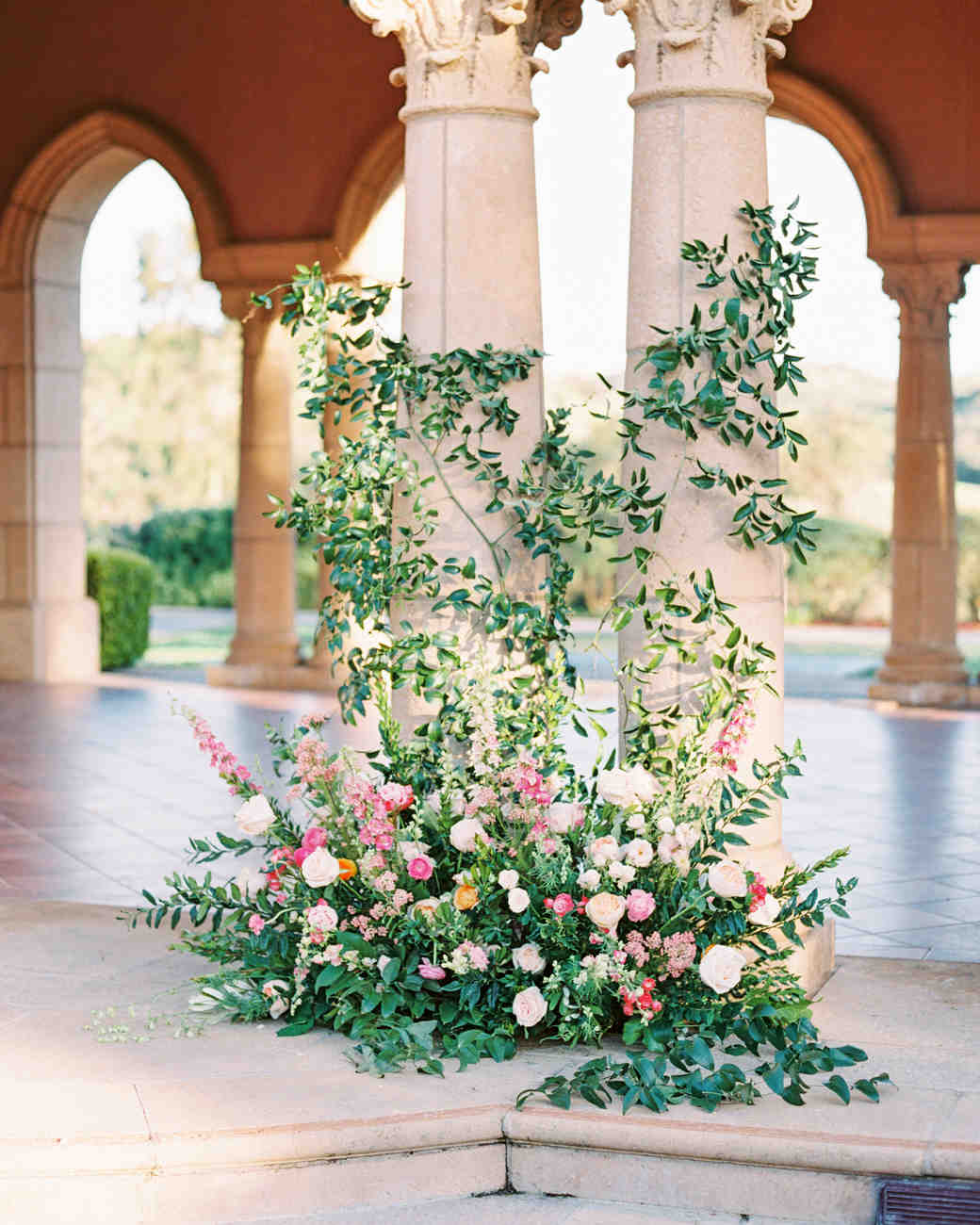 cavin david wedding floral installation in front of columns
