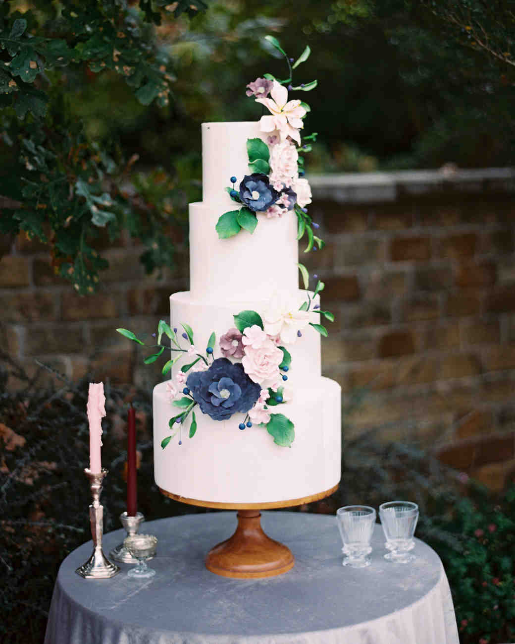 Wedding Cake With Blue And Purple Flowers