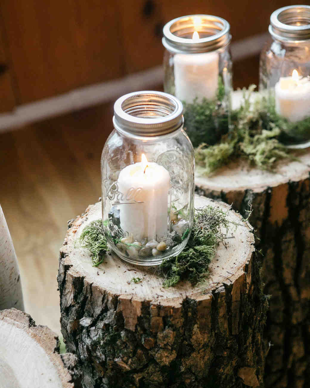 mason jar candle holder over tree stumps