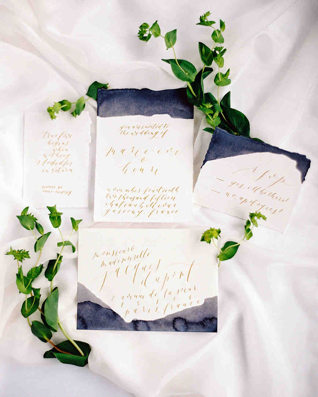 Elegant gold and navy watercolor and calligraphy invitation suite
