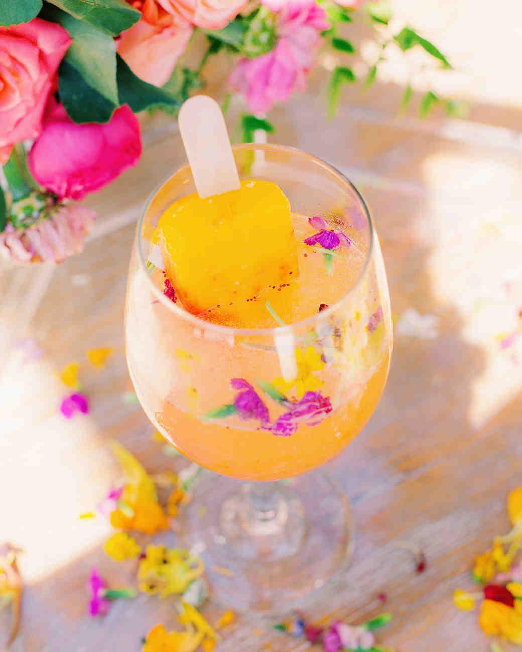 neon orange popsicle in champagne cocktail