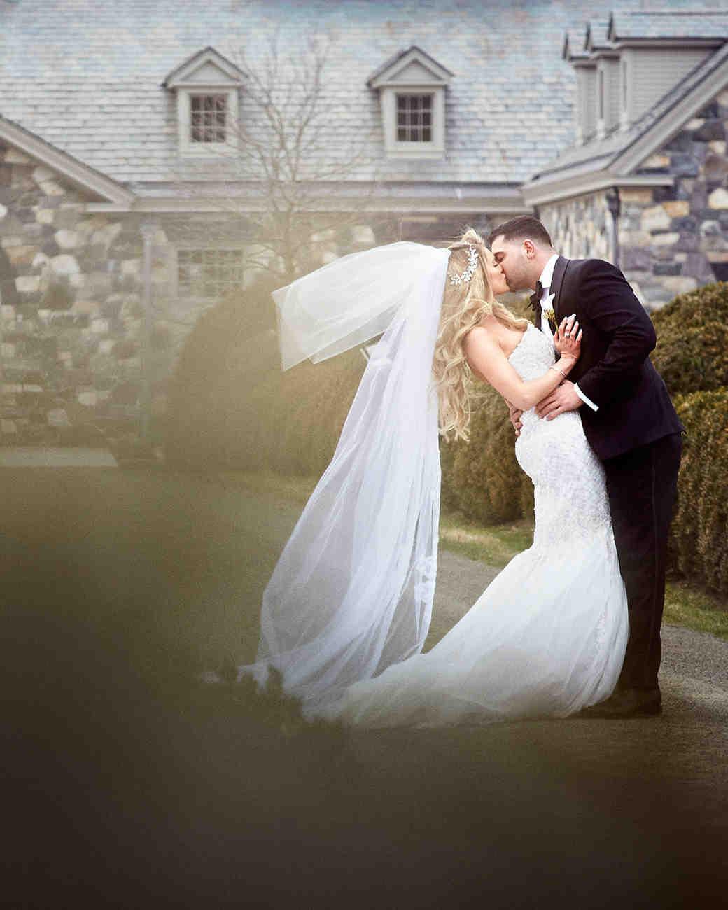 shqipe zenel wedding couple kissing on gravel walkway